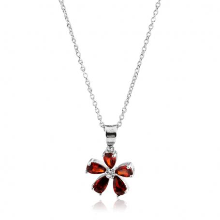 Colgante en forma de flor con piedra rubí.